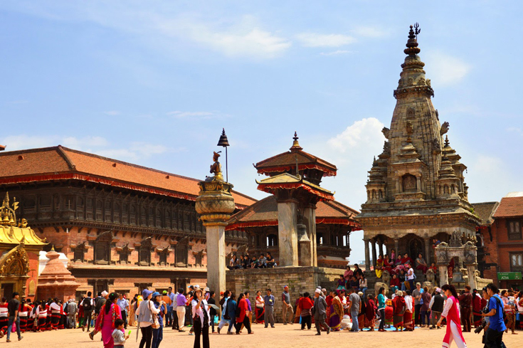 Bhaktapur Durbar Square, from left to right: Golden Gate, 55 Windows Palace, The Big Bell and the tallest temple in the picture - Vatsala Temple (destroyed by 2015 earthquake)