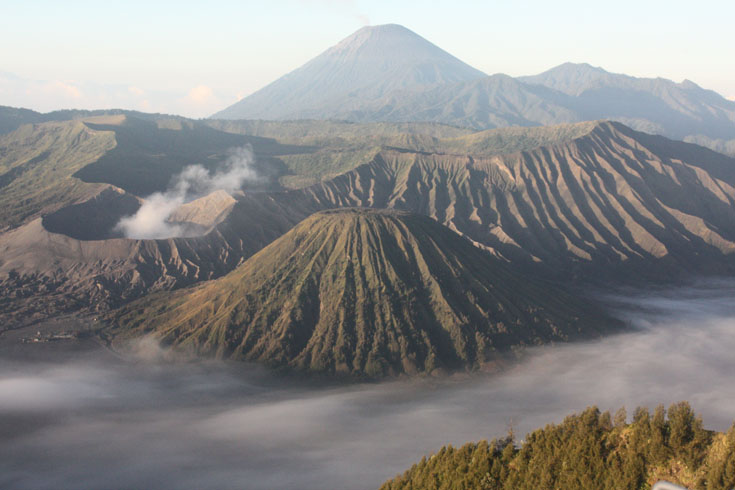 Mount Bromo, Mount Semeru and Mount Batok  Mount Bromo (Indonesian: Gunung Bromo), is an active volcano and part of the Tengger massif, in East Java, Indonesia.